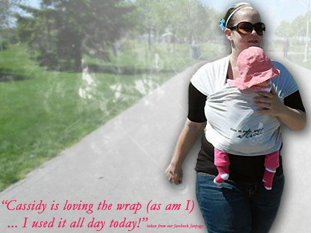 "Jenn wearing Cassidy and enjoying a walk in the park in our ""This is how we stroll"""