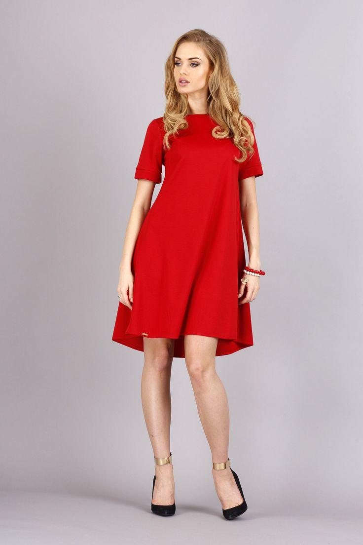 Trapezowa sukienka o luźnym kroju z krótkim rękawem. Rękawy zakończone mankietami. #modadamska #moda #sukienkikoktajlowe #sukienkiletnie #sukienka #suknia #sukienkiwieczorowe #sukienkinawesele #allettante.pl
