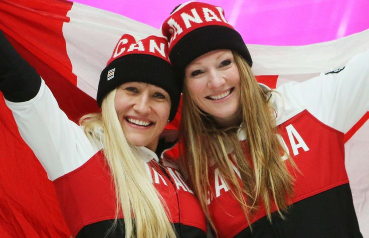 Kaillie Humphries, left, and Heather Moyse of Canada celebrate winning gold in the women's bobsleigh competition
