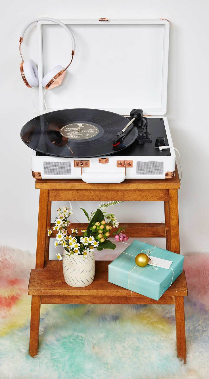 I like the idea of putting the record player on a cute little stool.