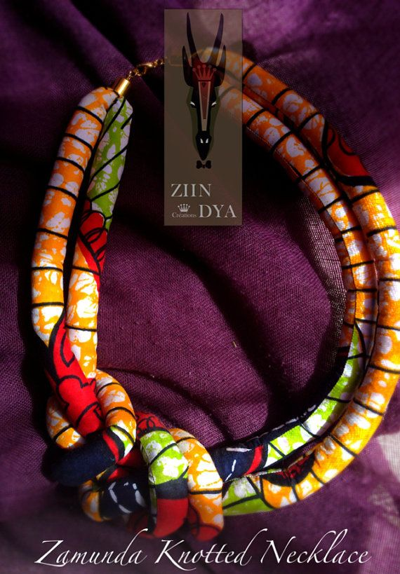 I should be able to replicate this beauty... I think.  Zamunda two row knotted Ankara neck piece
