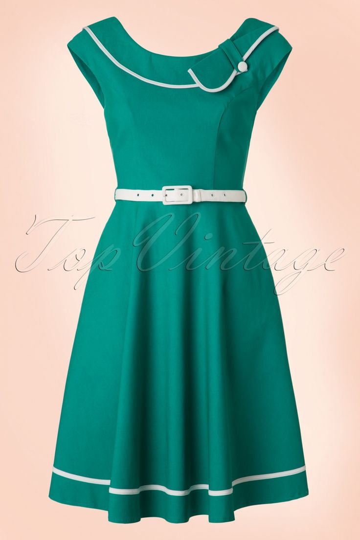 This 50s Nora Sailor Swing Dressis simply perfect!What a stunner!This flowy beauty features a stunning boat neck, V-neck at the back, playful white piping and a cute bow detail for a lovely vintage touch. The belt ensures a beautifully defined silhouette, oh la la! Made from a stretchy turquoise viscose blend for a lovely fit. The perfect dress to stroll along the avenue!   Cap sleeves Rounded collar White faux button at the neckline Side pockets Detachable fabric belt Hidde...