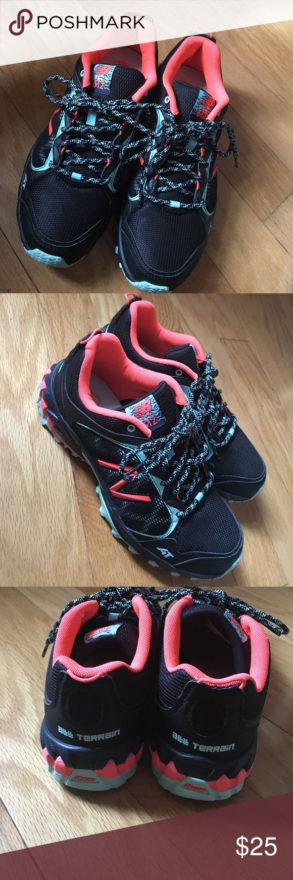 New Balance AT all terrain black sneaker NEW Brand new never worn size 8 in woman's black with aqua and coral accents. NB trail 612 AT all terrain sneakers. Price is firm as I am selling so low just to get them cleared out of my closet. New Balance Shoes Sneakers