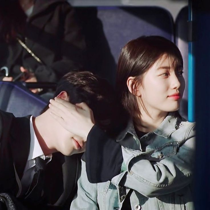 Hong Joo shades Jae Chun's eyes so he can sleep on the bus.