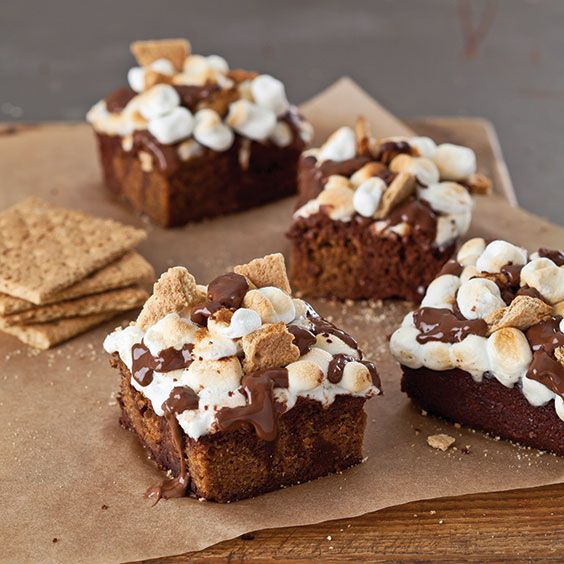 Toasty marshmallows, melted chocolate, and graham crackers a tap a luscious s'mores brownie bring back memories of evenings around the campfire.