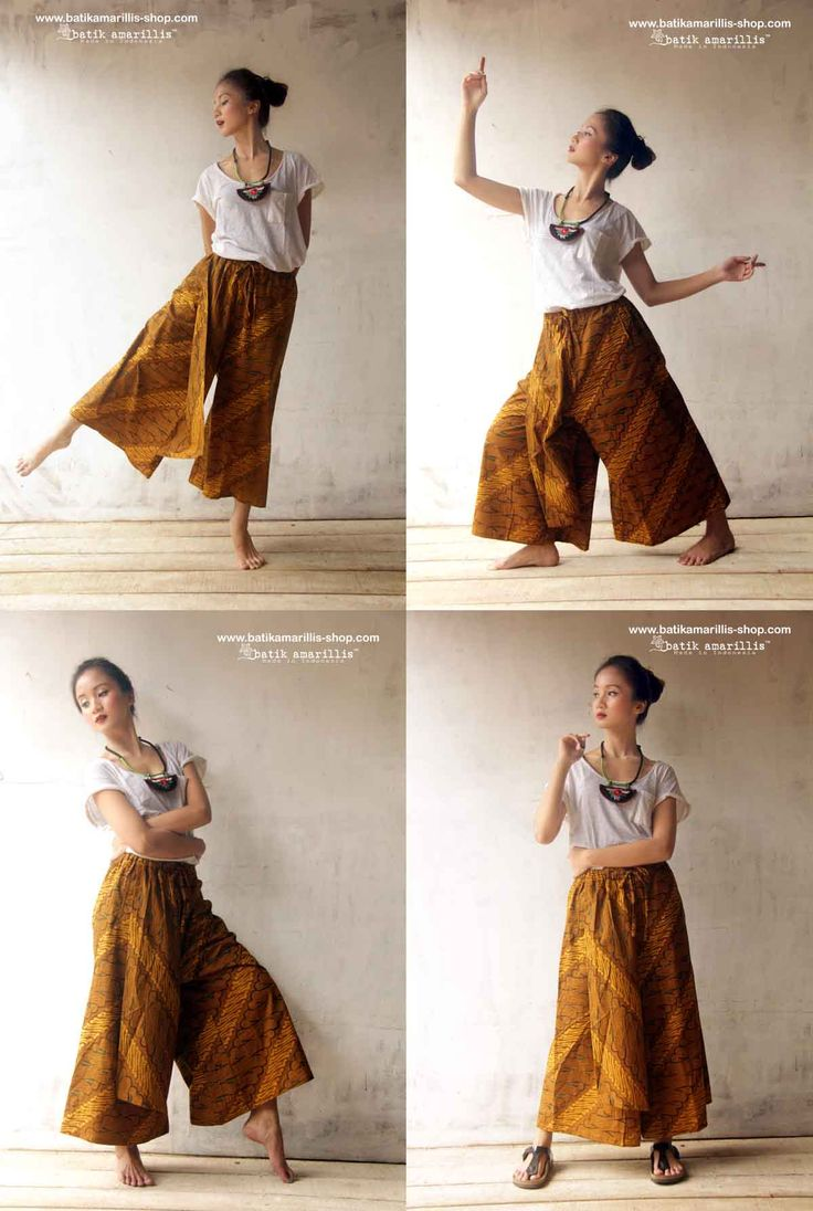 Batik Amarillis's joyluck Pants ..Unique and Lovely design plus very comfortable that you will want to live in them!  These pants have an elastic waist all around with wide shaped legs with layered asymmetric piece at the front.