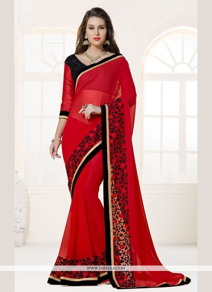 Add a vibrant burst of color in your wardrobe with this red faux georgette designer saree. The amazing dress creates a dramatic canvas with embroidered and patch border work. Comes with matching blous...