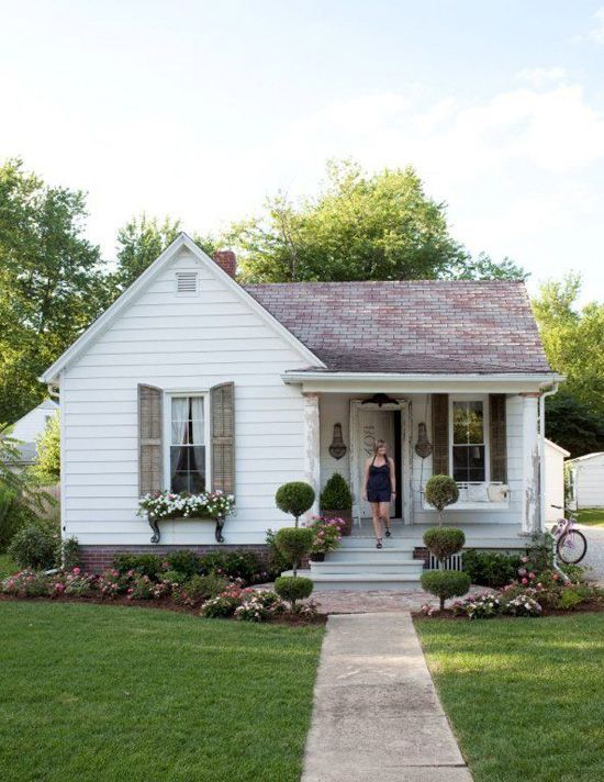 Dreaming of A Little White Farmhouse. Love the extended brick, flower box, and garden