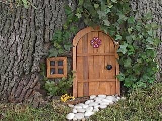 25 best ideas about tree lanterns on pinterest lanterns for Fairy doors for trees