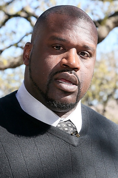 Shaquille O'Neal. My Dad saw him in the streets of his college, LSU, once. Even then he really stood out from a crowd!