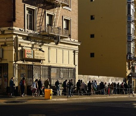 Another side of SF - A painfully familiar sight in the Tenderloin: the line for a free meal at Glide Church.