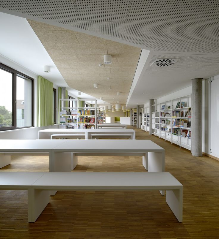Bildungszentrum Tor zur Welt / Bof Architekten, wood floor, tectum acoustical ceiling panels, acoustical gypsum, sloped ceiling, Library, Modern Benches and Tables