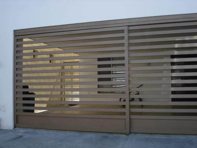 Contemporary Garage Doors and Gates. Stainless steel garage door, perfect for contemporary style houses www.garagedoor4less.com