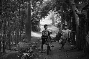 """Titled """"Two young boys in rural Nicaragua"""" this photograph highlights the devastating impact of chronic kidney disease in the Nicaraguan town of Chichigalpa. These brothers have lost cousins and uncles to a form of the disease which is thought to be linked to heavy labour in hot temperatures."""