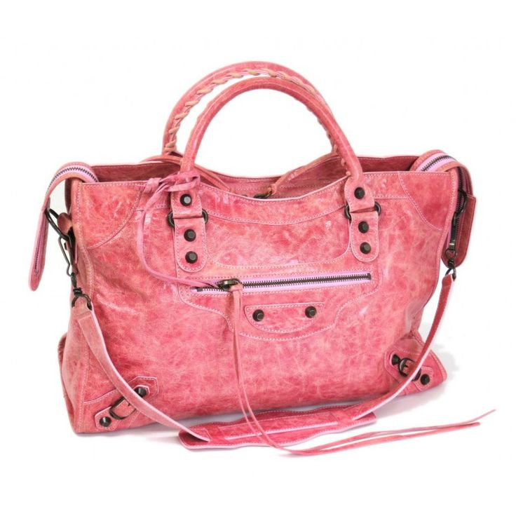 This authentic BALENCIAGA City Shoulder Bag is finely crafted from pink leather. The interior opens to a black textile. Featuring distressed pink leatherstrong rolled handles cut leather patches corner plates belts and tassels. The stud detailing buckles front pocket and top zipper adds a stylish cutting edge appeal that makes the City a classic design. A must have for all collectors of bags Fore more items like this visit https://www.swayy.com.au/
