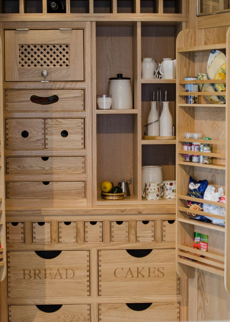 Solid oak pantry press in an inframe kitchen at Nehaven Kitchens.