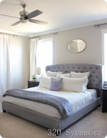 Love this site.  Great house tour.  master bedroom upholstered bed, paint colors
