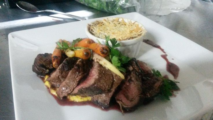 Beef with red wine jus, baby vegetables and potato and parmesan gratin.   Image courtesy of Sam Cooper - Head Chef at Victoria Falls River Lodge