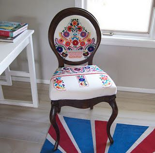 This DIY chair was recovered with a Mexican Dress.  I have a Mexican Dress that I can't wear!  Now I just need a chair to reupholster it with.