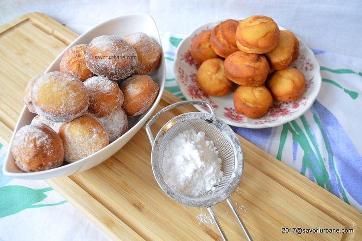 Gogosi de post pufoase si aromate reteta simpla. Gogosile pot fi prajite in ulei sau coapte in cuptor. Gogosi pufoase fara oua sau lapte, facute cu suc si pulpa de portocale si aromatizate cu vanilie si coaja de lamaie. Un dulce simplu de post, ieftin, rapid si usor de preparat. ADVERTISEMENT - PUBLICITATE Daca facem …