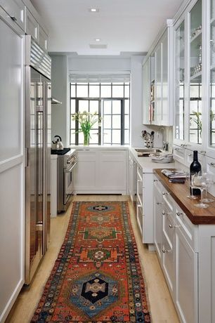 NEED 2 GET MY RUGS FROM STORAGE     Eclectic Kitchen with Custom wine storage, Corian- Designer White, Corian counters, Wood counters, Galley, Undermount sink
