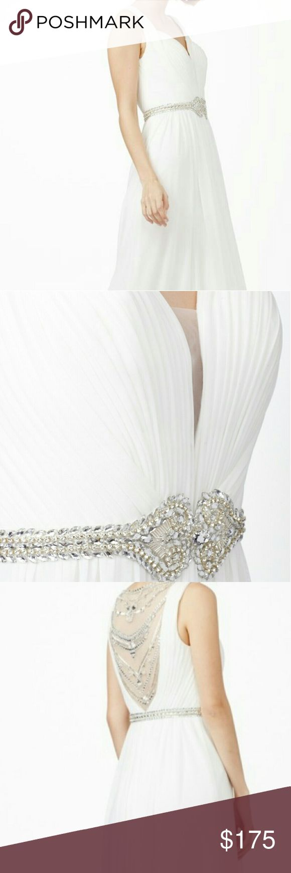 Jovani Wedding Dress Stretchy & comfy mesh material with a sweetheart neckline that creates a thin V cut above a gorgeous belt of rhinestones. The low back is coated with a sheer material with beautifully placed rhinestones throughout. Jovani Dresses Wedding