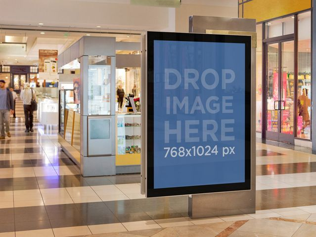 Mall Poster near a koisk. Try it out at: https://placeit.net/c/print/stages/squared-ad-on-a-mall