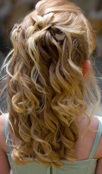Curly flower girl hair.