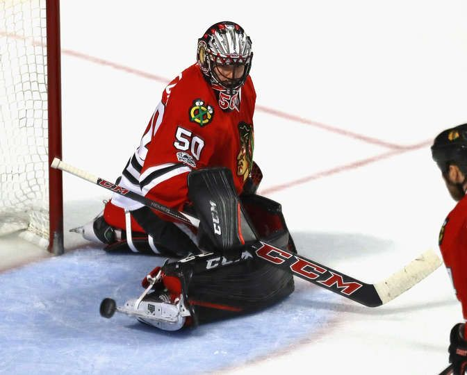 CHICAGO, IL - JANUARY 22: Corey Crawford #50 of the Chicago Blackhawks makes a save off of his skate against the Vancouver Canucks at the United Center on January 22, 2017 in Chicago, Illinois. The Blackhawks defeated the Canucks 4-2. (Photo by Jonathan Daniel/Getty Images)