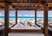Cancun Beachfront Bali Beds  JW Marriott Cancun Resort & Spa. A sensational beachfront location in Cancun's famous Hotel Zone, as well as five-star resort lodging and a remarkable selection of luxury amenities.