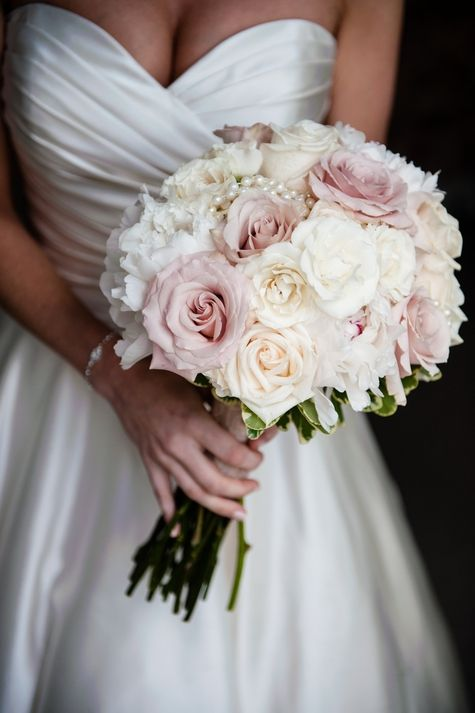 Classic pastel flowers. Gorgeous!   Blush and white bridal bouquet with pearl accents // Danielle's Designs Florist Shop // Melissa Mullen Photography