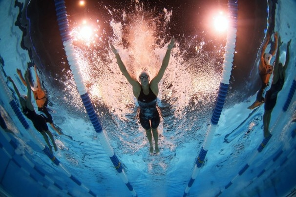 From left to right, Lyndsay De Paul, Dana Vollmer and Natalie Coughlin compete in the Women's 100 meter butterfly during the 2012 U.S. Olympic swimming team trials.