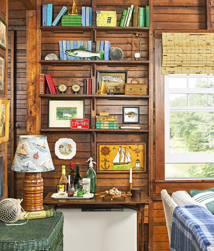 Featuring salty finds, no-frills furnishings, and one heckuva view, this formerly drab fixer-upper on Maine's Boothbay Harbor is now a beacon for game nights, lobster bakes, and the requisite vacation puzzles. Here's how the pieces fell into place.