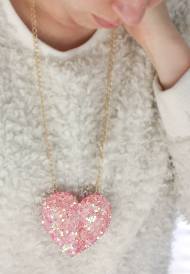 This is a super simple DIY for a Disco Heart Necklace! A perfect glitzy accessory that doubles as a place to write a sweet Valentine's message!