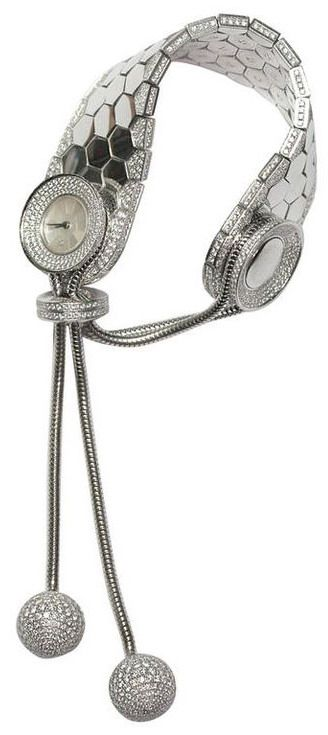 van CLEEF & ARPELS 80's lady's watch in white gold set with diamonds, mother of pearl bezel, two round pendants with diamonds, two snake mesh cords clasp as a sliding a button, numbered 144357, 338986 reference, width 2,2cm (152.15 grams)