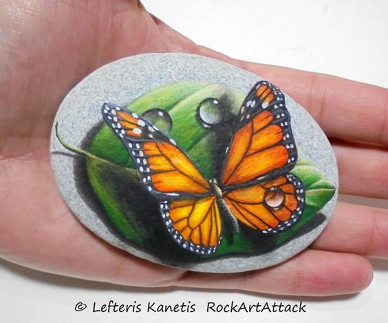 Stone painting monarch butterfly on green leaf with waterdrops! Original acrylic painting on natural sea stone, finished with satin varnish
