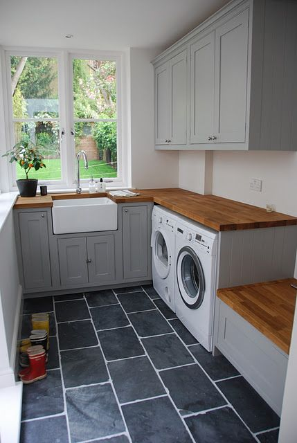Slate floor, apron front sink and lots of light- I also really like having a counter top over the washer & dryer!