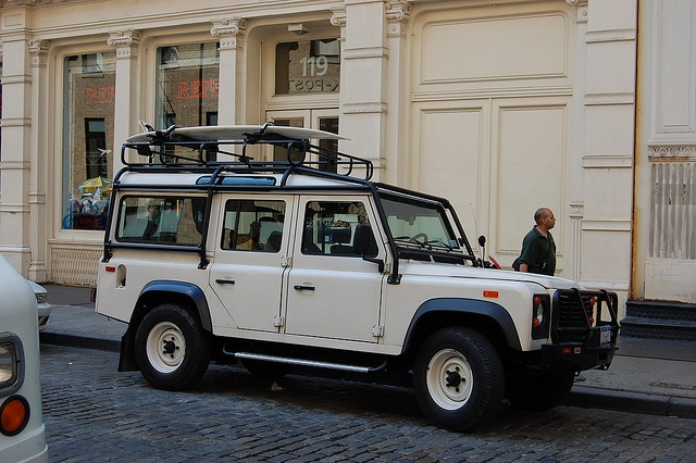 Land Rover Defender 110 and surfboard