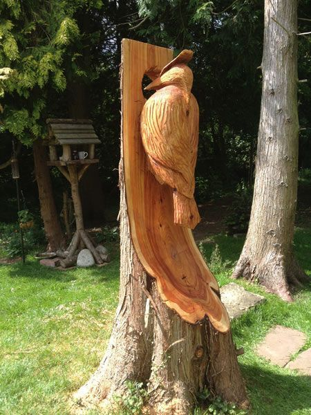 Chainsaw carved dragons giant woodpecker thinks to