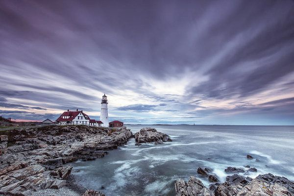 This photograph of a lighthouse was taken near Portland, Maine at sunset.