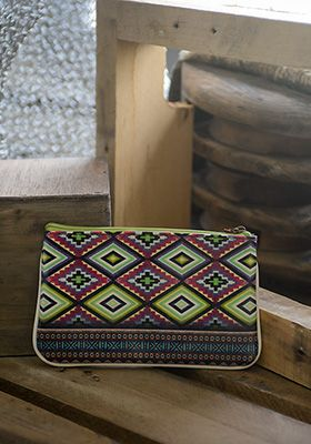 """You know the saying, """"A print can say a thousand words""""...well...close enough. We can't help but imagine sandy beaches, margaritas, and mariachi bands when we look at this funky little purse.  www.shopculture.ca"""