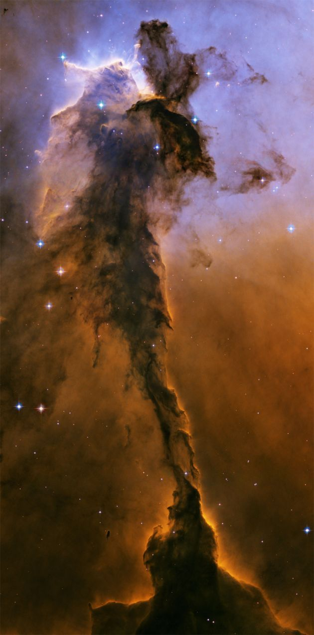 The Eagle Nebula is a billowing tower of gas and dust that rises up from a heavenly nursery. This small piece of the Eagle Nebula is 57 trillion miles long!