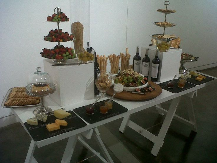 |A Cheese and Wine| table adds a fun element to any occasion as well as a way for guests to interact.