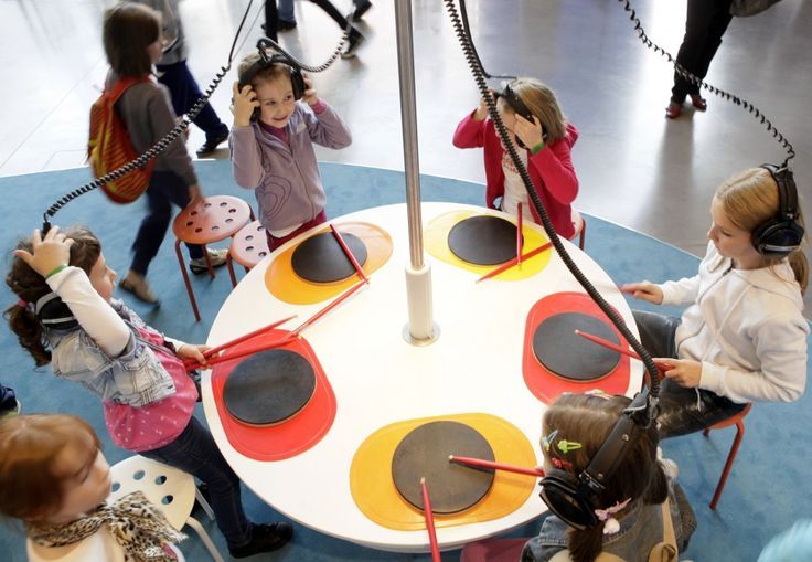 Wouldn't something like this be great to have in your studios waiting room? Maybe a full drumset would be better!    Children wear headphones as they drum on a simple percussion instrument to explore musical sounds at a tonal exhibition sound workshop at the popular Nicolaus Copernicus Science Center in Warsaw, Poland. (AP)