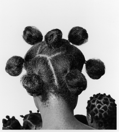 Nigerian woman hair style back in those days with their natural beauty