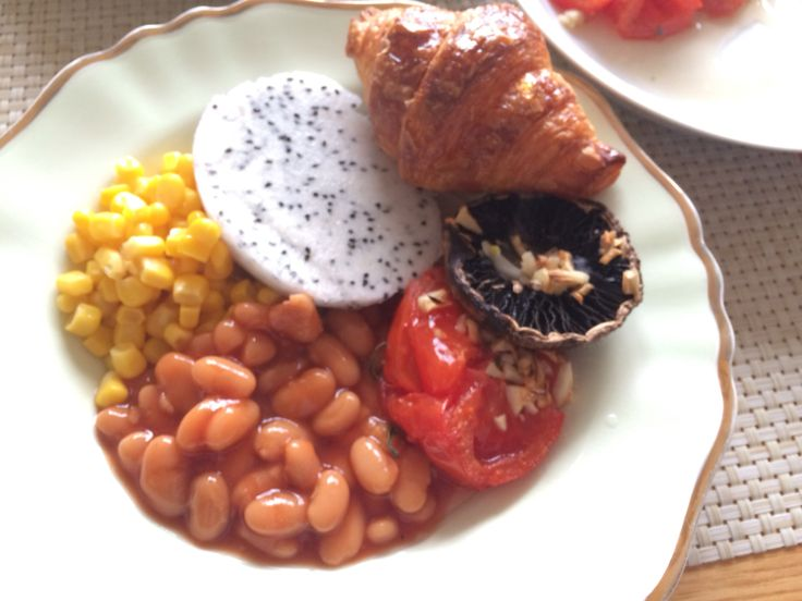 Roasted tomato, mushroom, corn, bean, dragon fruit with crossiant ...