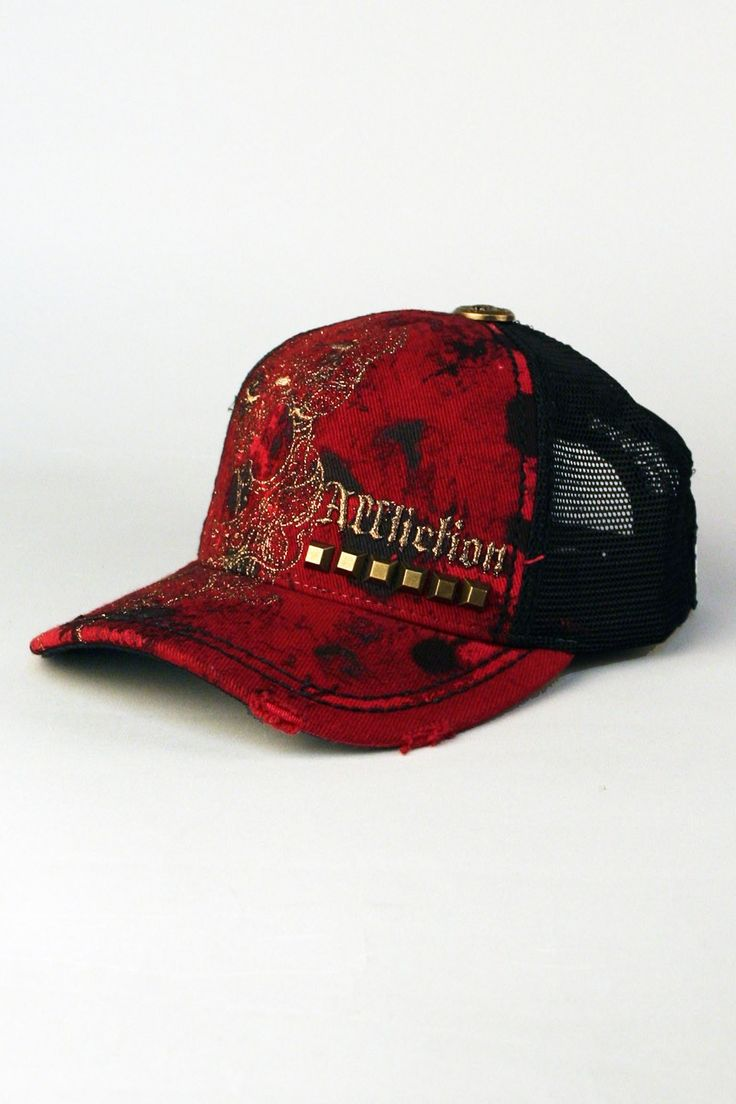 Affliction® Mosher Trucker Hat in Red for Men and Women.  Affliction clothing brings style to truckers and brings truckers to style-makers. White on black Mosher Trucker Hat is a can't-miss alternative to mens fitted caps. Bonus style and attitude points for super cool design featuring a swath of awesome embroidery on the right, the Affliction brand on left underlined by a row of studs, distressed brim and a metal gauge accent on top. Ladies, do NOT be fooled by the name: this Affliction…