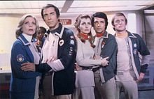 Space: 1999. OMG, LOVED this show! It ran from 1975-1977 and starred Barbara Bain and Martin Landau, real-life husband and wife (hugging at left). The other girl in the shot (center), named Maya, was a shape-shifter. I wanted to be her!! LOL I saw it in reruns on PBS.