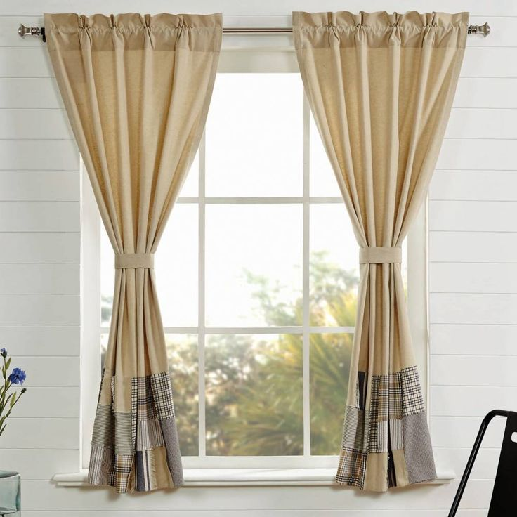 """Includes two panels with matching tie-backs. Features natural beige chambray fabric with a 15"""" patchwork border along the bottom. 100% cotton, lined with white cotton, 2"""" header and 3.25"""" rod pocket. Curtains measure 63""""L x 72""""W, ((each panel measures 63""""L x 36""""W).  #farmhouse #country #panel #curtains"""