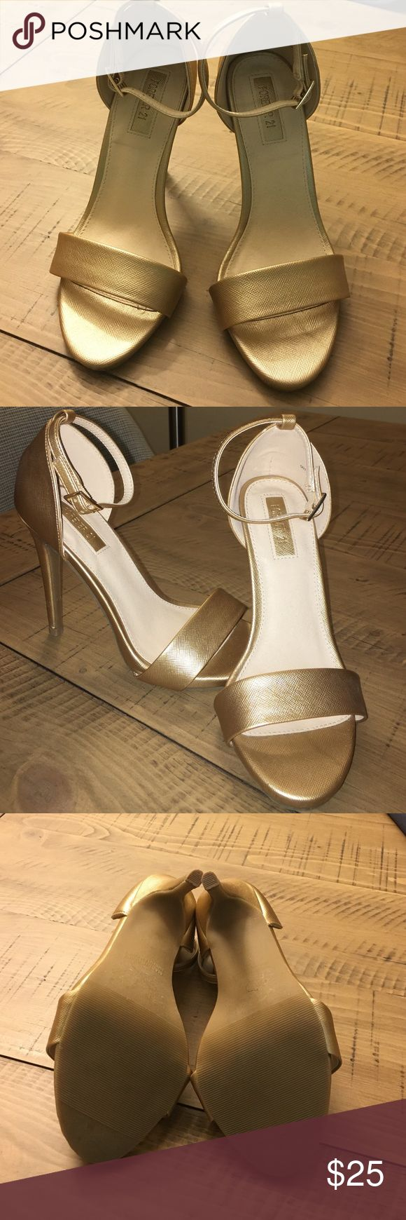 NWOT gold sandal heels Gorgeous metallic gold color heels. Brand new and never worn. Heel height is 4inches. Straps around ankles. Comes from a pet and smoke free home. True to size. Forever 21 Shoes Heels